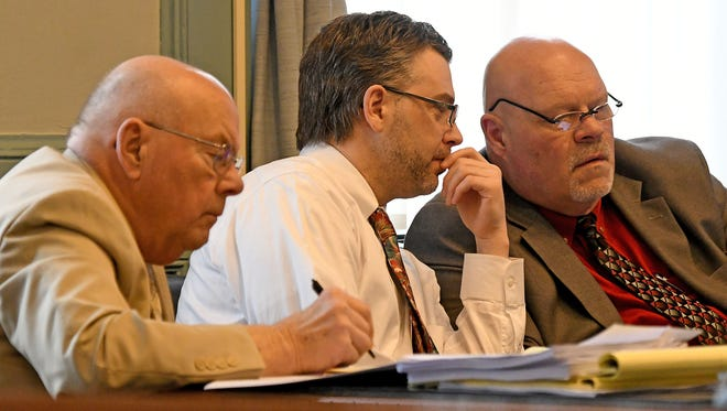 Accused killer Shawn Grate sits with his attorneys Bob Whitney and Rolf Whitney as the listen to testimony during Grate's murder trial in Ashland on Wednesday.