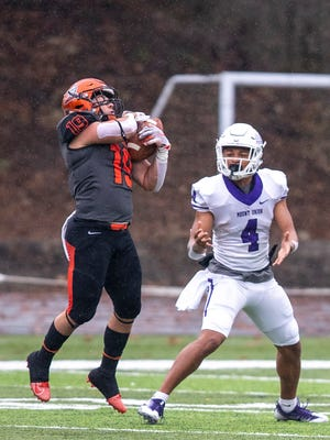 Heidelberg inside linebacker Dylan Marder intercepts a pass against Mount Union in 2018. The 2016 Aurora graduate finished with 27 tackles for the Student Princes last fall.