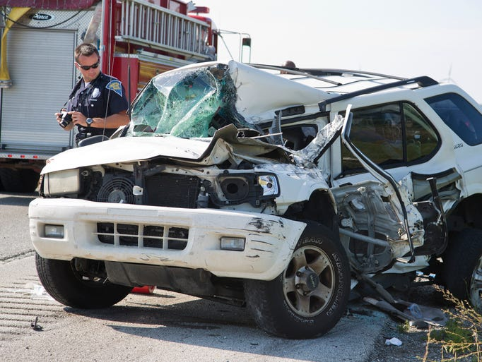 Law enforcement officials investigate a crash on Interstate 65 that sent the driver of this vehicle to IU Arnett Hospital Thursday, August 28, 2014, near Battle Ground. Police say alcohol may have been a factor in a the crash.