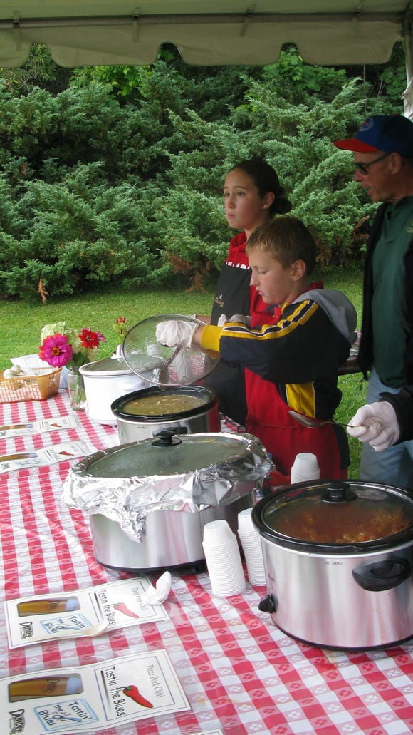 Getting the chili ready for sampling and judging was a family affair.