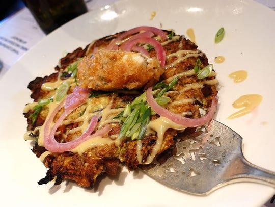 Okonomiyaki with cabbage, smoked salmon and cream cheese at Provisions in Houston.