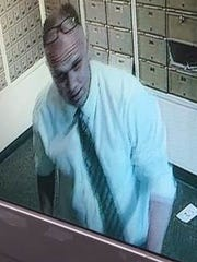 This man is suspected of burglarizing two UPS Stores