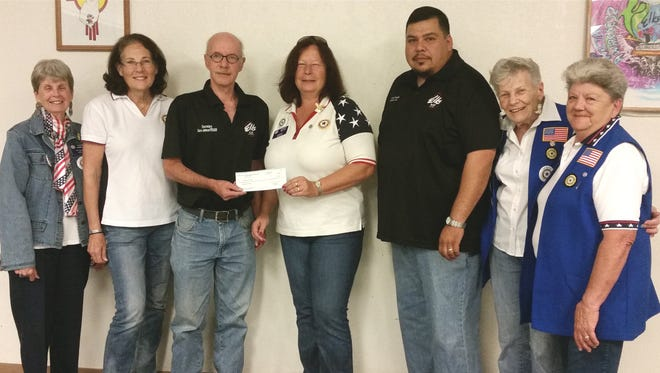 Pictured, in no order are: Barbara Horning, Aux. vice president; Marion Harrop, Aux. member at large; Dave Johnson, Elks secretary; Gwen MIller, Aux. president; Ernie Arrey, Elks chairman of the board of directors and Connie Hamilton, past Aux. president.