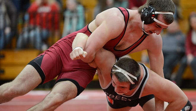 At top, Pulaski's Levi VanLanen stays in control of Green Bay Preble/East's Casey Nelson during their 220-pound match in Thursday night's wrestling dual at Pulaski High School in Pulaski. VanLanen won the match. Evan Siegle/Press-Gazette Media