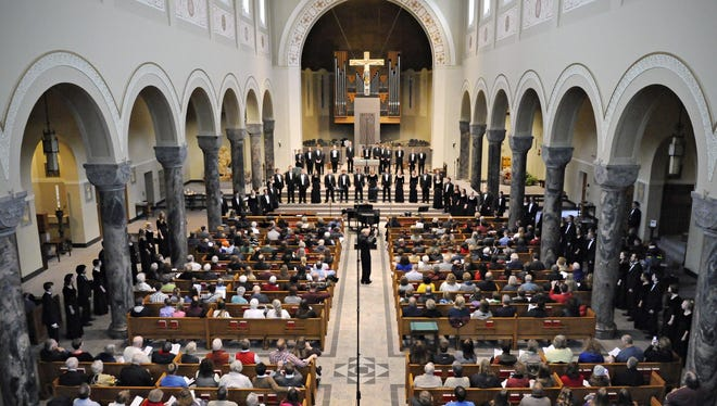 The St. Cloud State University concert choir circled the sanctuary of St. Mary's Cathedral for a song during their performance in downtown St. Cloud.