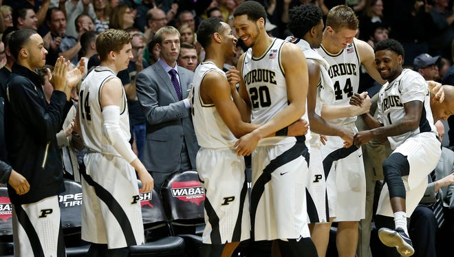 A.J. Hammons and Johnny Hill are greeted by their teammates as they come out of the game late against Wisconsin Sunday, March 6, 2016, at Mackey Arena. Purdue defeated Wisconsin 91-80.