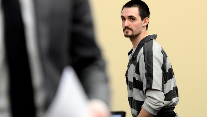 Mikael Frutin, 26, looks back into the gallery as he exits the courtroom Wednesday after being sentenced to three to 15 years in prison. He pleaded guilty in March to two counts of third-degree criminal sexual conduct.
