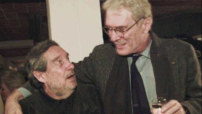 FILE - In this Nov. 18, 1995, file photo, former U.S. Poet Laureate Mark Strand (R) meets with Ocatavio Paz, Mexican author and Nobel Prize winner for literature, in Mexico City.