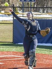 Morris Catholic catcher Katie Forte throws the ball