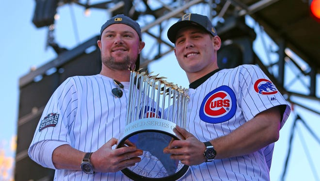 Cubs' Jon Lester (left) and Anthony Rizzo hold the World Series trophy.