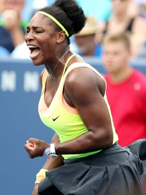 Serena Williams yells after she won a point over Tsvetena Pironkova during the Western & Southern Open at the Lindner Family Tennis Center in Mason Aug. 19. Williams went on to win  7-5,6-3.
