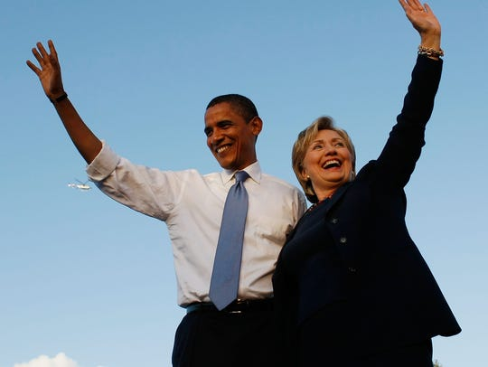 Then-senators Barack Obama and Hillary Clinton during