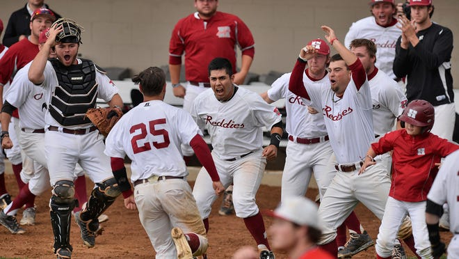 Henderson State players celebrate as they tie the score 7-7 in the eighth inning Sunday against St. Cloud State in their NCAA Division II Central Regional championship round game. The game was stopped shortly afterward due to rain and lightning in the area.