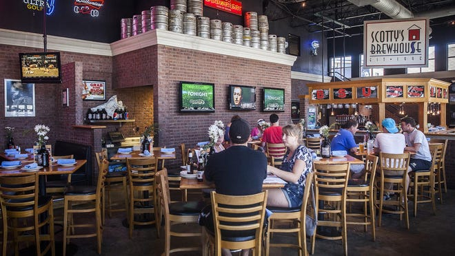 Customers have lunch at Scotty's Brewhouse Saturday.