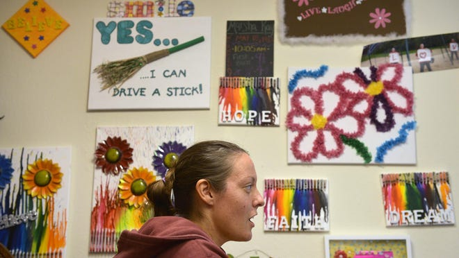 Marsha Hagfors has found art and positive messages throughout her St. Cloud apartment are helpful forms of therapy for her as she copes with bi-polar disorder. She spoke in June 2015.