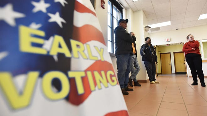 Early voters wait outside the Oneida County Board of Elections at Union Station in Utica Saturday, October 26, 2019. Oneida County Democratic Election Commisioner Carolann Cardone said in-person early voting is a safe alternative amid the coronavirus pandemic.