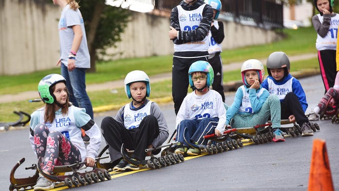 In this 2019 file photo, children learn how luge in Utica as part of the USA Luge slider search program.