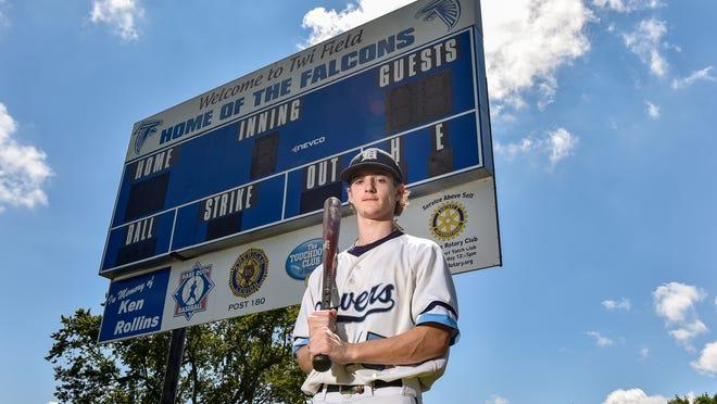 Danvers High School baseball Falcon Ben Olszak poses for a photo in front of the Twi Field scoreboard on Monday, July 6.