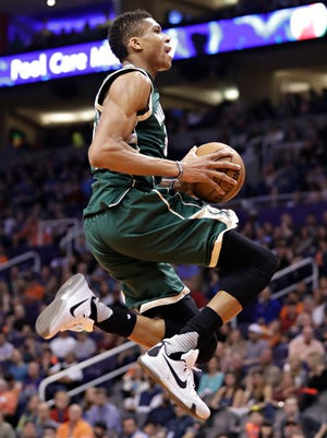 Bucks forward Giannis Antetokounmpo goes up for a dunk Saturday night against the Suns. Antetokounmpo had 30 points, 12 rebounds, six assists and four blocks in Milwaukee's victory in Phoenix.