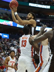 St. Bonaventure Bonnies forward Courtney Stockard (11) shoots against the Florida Gators in the first round of the 2018 NCAA Tournament at American Airlines Center in Dallas on March 15, 2018.