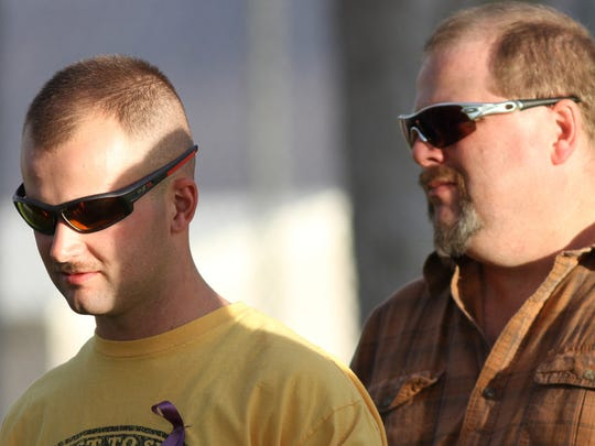 Widower Jonathan Corwin and his father Tom Corwin stand together during a vigil to remember Erin Corwin, which was held at Luckie Park in Twentynine Palms, Calif. on Monday, August 25, 2014.
