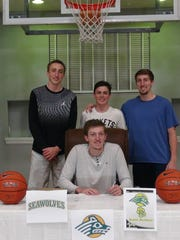 Galena graduate Josiah Wood, seated, shown with his brothers, signed with Alaska-Anchorage.