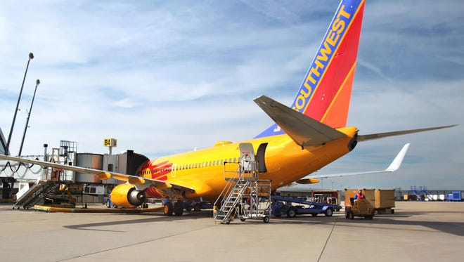 Members of members of Transport Workers Union Local 555, are protesting working conditions for ground-crew members and flight delays that are straining operations and hurting customer service. A Southwest Airlines jet is shown at the Indianapolis International Airport terminal in this September 2013 photo.