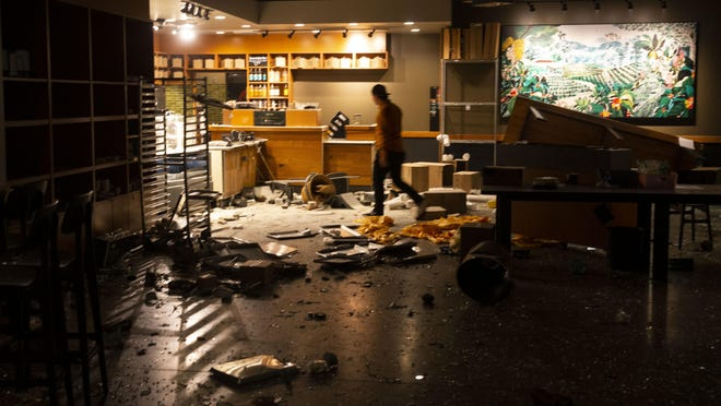 A man walk through the looted Starbucks in the early morning hours of May 30 after a May 29 protest in Eugene over the killing of George Floyd in Minneapolis, Minnesota. [Chris Pietsch/The Register-Guard file] - registerguard.com