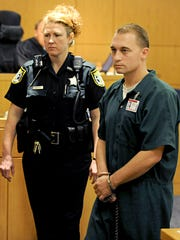 Leonard Gonzalez Jr. is led out of the courtroom by court security officer Candace Freeman after being denied bond Aug. 12, 2009.