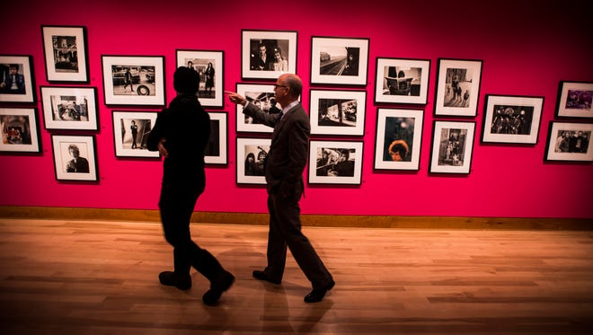 Vermont musician Kris Gruen and Shelburne Museum Director Tom Denenberg walk through the museum's new exhibition ÒBackstage Pass: Rock & Roll PhotographyÓ. The exhibit creates a unique blast from the past for Gruen. He encountered many of the performers depicted in the exhibition while tagging along with his father, famed rock photographer Bob Gruen, during photo shoots in the 1970s and Ô80s.