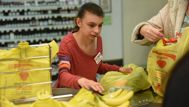 Pascack Valley Regional High School student Juliana Lavitol bags groceries at the ShopRite in Hillsdale.