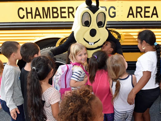 Students thank Buzzy the Safety Bee (Lisa Deaven) on Thursday, October 20, 2016 at Stevens Elementary School. CASD Transportation workers conducted a bus safety lesson at the school.