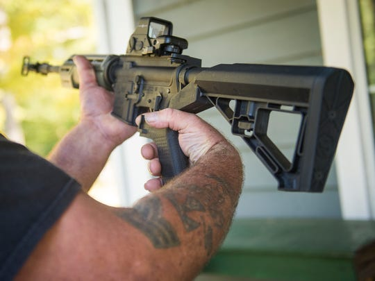 Gun owner Steven Straub decided to destroy the bump stock he owned for his AR-15, seen as the end of the pictured gun, after learning the Las Vegas shooter used one during the shooting.