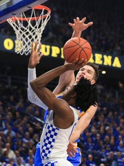 UCLA's Thomas Welsh blocks Kentucky's De'Aaron Fox in the first half in the Bruins' upset win over the Wildcats 97-92 Saturday afternoon at Rupp Arena.
