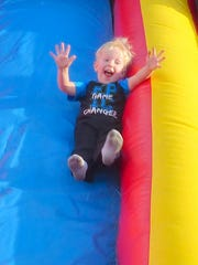 The joy of going down a slide shows on this little boy's face.