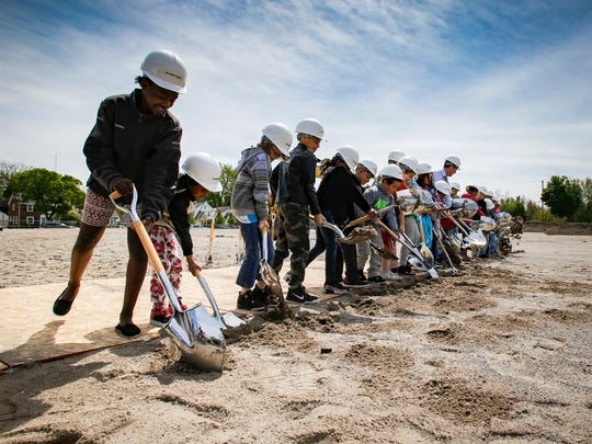 3rd-graders from Fairview STEM Magnet School in Lansing participated in a groundbreaking ceremony Wednesday where a new classroom wing will be built.