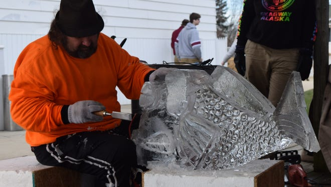 An ice sculptor carves the likeness of Benny the Bass at a previous Winterfest. Buckeye Lake's annual festival is this weekend.