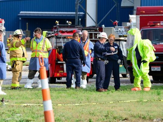 Emergency responders participate in a hazardous-materials