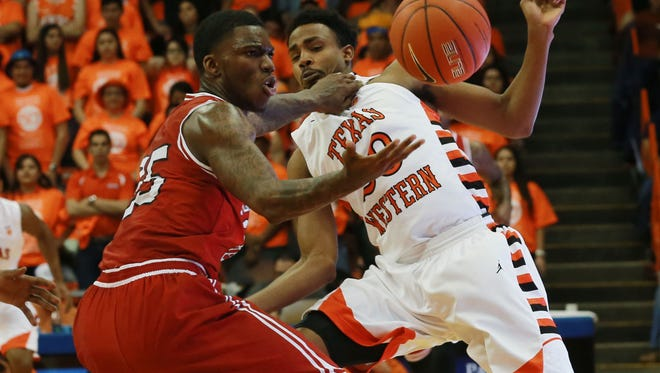 UTEP's Earvin Morris, right, pressured Western Kentucky's Frederick Edmond in the backcourt late in the game Saturday.