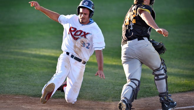 Ben DeLuzio of the Rox slides into home during Tuesday's game against Willmar at Joe Faber Field in St. Cloud.