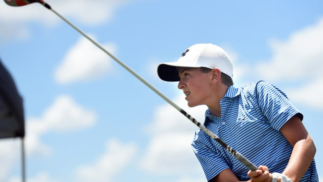 Samuel Kodak, 13, of Naples watches after his drive during the Drive, Chip, & Putt subregional qualifying competition at  the PGA Center for Golf Learning and Performance on Saturday, Aug. 13, 2016, in Port St. Lucie.