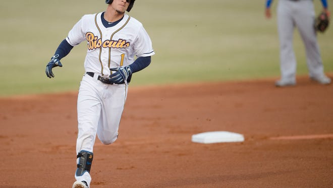 Biscuits center fielder Andrew Velazquez rounds second after hitting a home run on the first pitch of the game during the Montgomery Biscuits season home opener against the Biloxi Shuckers on Thursday, April 5, 2018.
