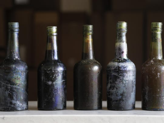 This March 4, 2019, photo shows beer bottles recovered from the shipwreck of the SS Oregon, at the St. James Brewery in Holbrook, N.Y.