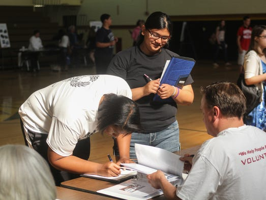 Tinton Falls, NJ -        Chloe Yelle, left, and Laura Castillo, right, at the U-Prosper Reality Fair at Monmouth Regional High School sponsored by United Teletech Financial Federal Credit Union. Students learned about managing personal finances.