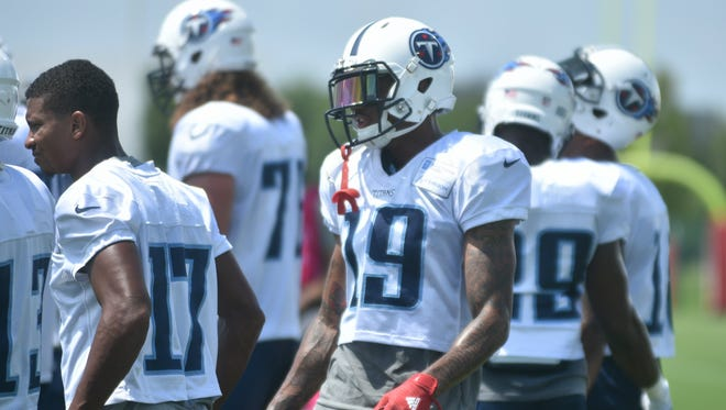 Tajae Sharpe (center) returned to the practice field for the Titans on Monday.