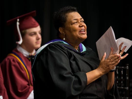 Principal Willie Dickerson claps during Franklin High School's graduation ceremony at Lipscomb University's Allen Arena, Saturday, May 21, 2016, in Nashville, Tenn.