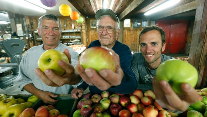 Three generations of the Schutt family, Martin, Charles and Evan, shown in 2015 at Schutt's Apple Mill in Penfield, near the Webster border.