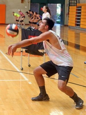 Andreo Otiniano, a senior at Mamaroneck High School, and a member of the girls volleyball team, practices with the team Sept. 16, 2015. Otiniano played with the team as a sophomore, and still practices with the team and is on the roster, but present Section 1 rules do not allow him to play in matches.