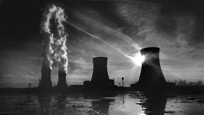 This 1979 photo of Three Mile Island shows steam rising from the unit that was damaged by a near meltdown two weeks later.