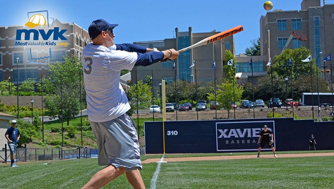 Chris Mack swings for the fences in the second Xavier basketball Softball World Series at Hayden Field. The third edition is Wednesday at 3 p.m. The public is welcome.